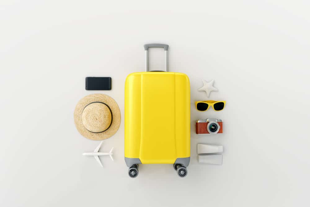 yellow suitcase with traveler,luggage
